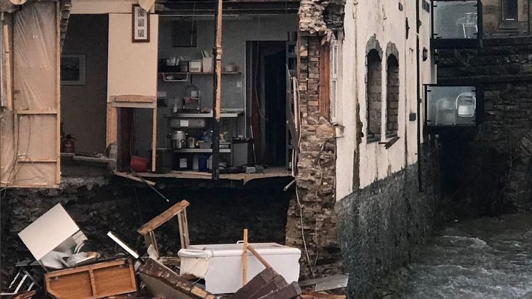 A wall shared by the Bridge House Guest House and Sonia's Bistro in Hawick, in the Scottish Borders, collapsed into the River Teviot