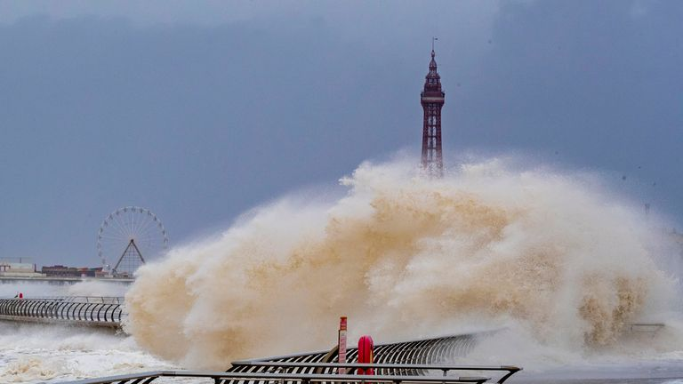 Waves crash over Blackpool waterfront as weather warnings for wind, snow and ice have been issued