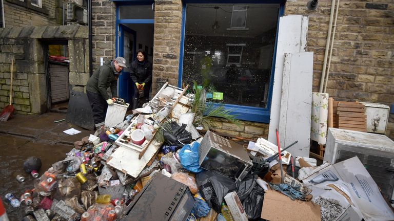 MYTHOLMROYD, ENGLAND - FEBRUARY 10: Staff beginning cleaning the Blue Tea Pot cafe as residents begin clearing up following severe flooding beside the River Calder on February 10, 2020 in Mytholmroyd, West Yorkshire, England. (Photo by Anthony Devlin/Getty Images)