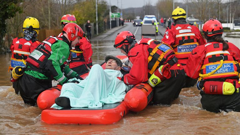 An elderly man is rescued from his home in Monmouth