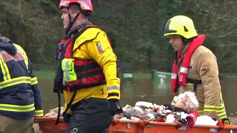 An elderly woman has been rescued from her property in the flooded village of Nantgarw, South Wales, after Storm Dennis.