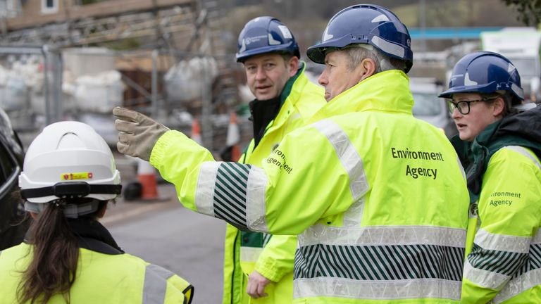 Environment Agency workers were seen in Mytholmroyd in West Yorkshire yesterday