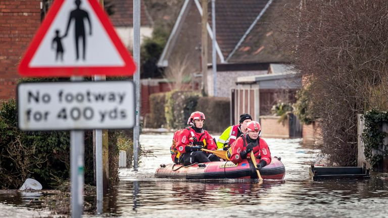 Rescue workers in East Cowick, Yorkshire, after heavy rain and winds from Storm Jorge