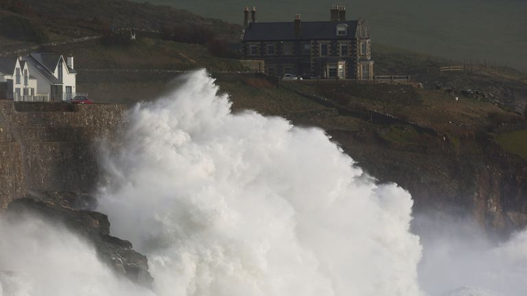 Waves crash into the wall at Porthleven in Cornwall, as Storm Ciara pummels the British coastline