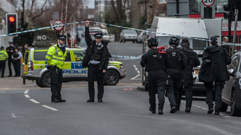 LONDON, ENGLAND - FEBRUARY 2: Armed and specialist Police officers head into the cordon after a man was shot and killed by armed police on February 2, 2020 in London, England. The Metropolitan police have said that a number of people had been stabbed during a terrorist-related incident in Streatham. (Photo by Guy Smallman/ Getty Images)