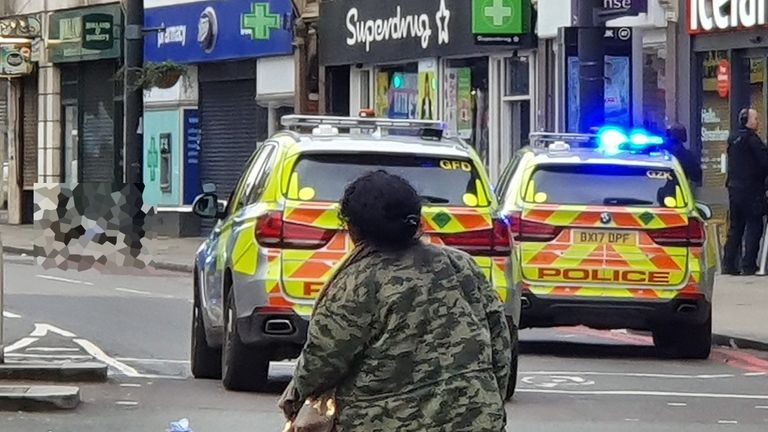 Police at the scene of the incident on Streatham High Street