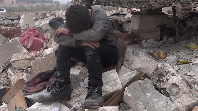 12-year-old Mohammed Al Halabi searched for his three siblings in the rubble of his home