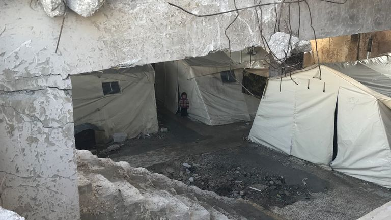 People living under a former football stadium in Idlib