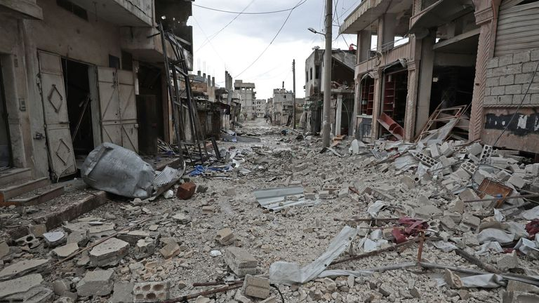 Debris fills the streets of Sarmin, a town close to Idlib in northwestern Syria