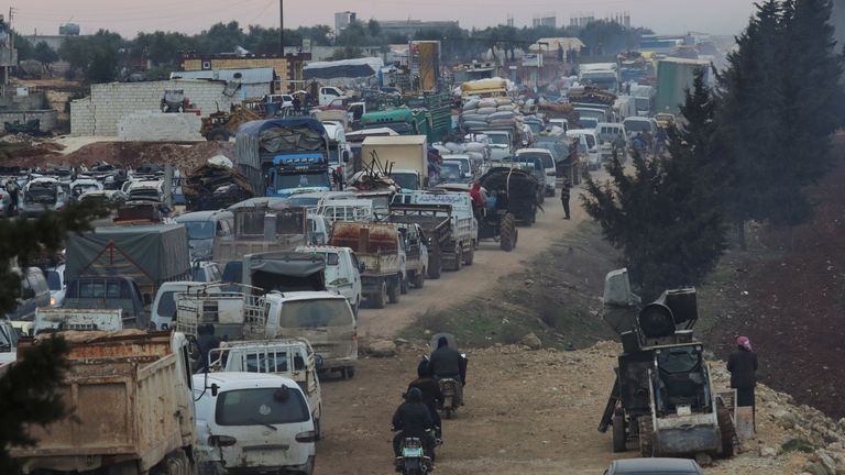Trucks carrying the belongings of displaced Syrians in Idlib province