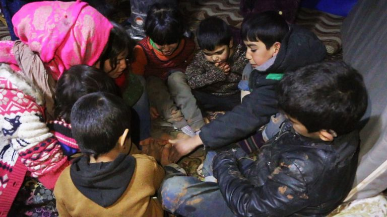 Children on the move in Syria play for a brief moment