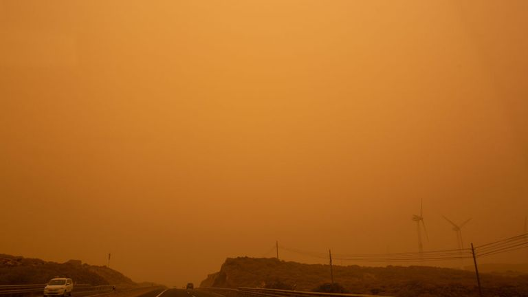 Cars drive on the TF-1 highway during a sandstorm in Santa Cruz de Tenerife, on the Canary Island of Tenerife, on February 23, 2020. - Airports on Spain's Canary Islands were closed after strong winds carrying red sand from the Sahara shrouded the tourist hotspot. (Photo by DESIREE MARTIN / AFP) (Photo by DESIREE MARTIN/AFP via Getty Images)