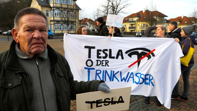 Demonstrators hold anti-Tesla posters during a protest against plans by U.S. electric vehicle pioneer Tesla to build its first European factory and design center in Gruenheide near Berlin, Germany January 18, 2020.