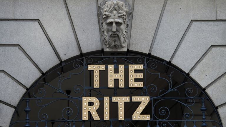 A photograph shows the sign outside the Ritz Hotel in central London