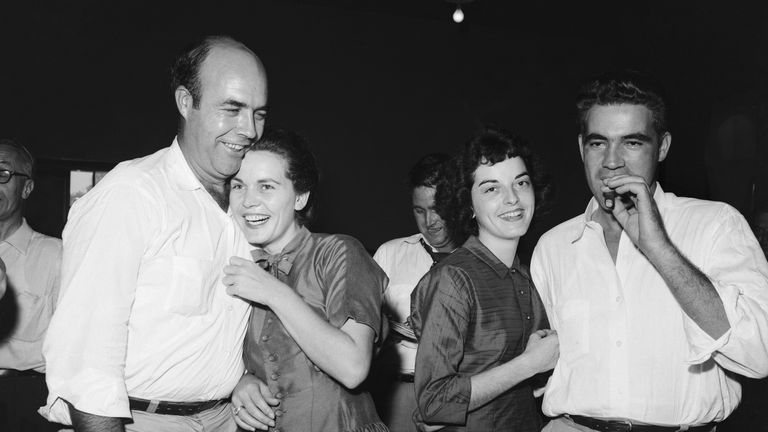 Roy Bryant (left), his wife Carolyn and J.W. Milam with his wife after the men were acquitted of till's murder
