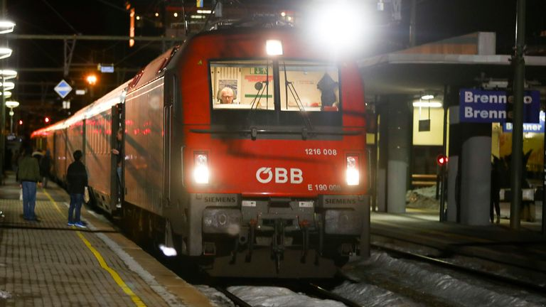 A train stopped by authorities stands on the tracks at the train station on the Italian side of the Brenner Pass, Italy