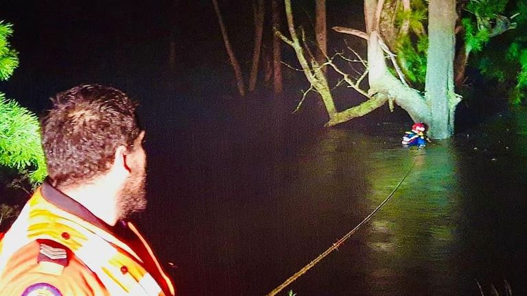 NSW State Emergency Services crews rescue a man who was swept down a river and had to cling to a tree for 10 hours. Pic: Bega Valley Units