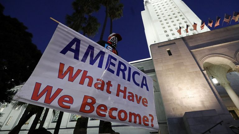 A protest against the impeachment acquittal outside city hall in Los Angeles