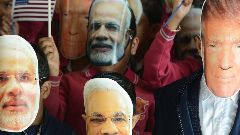 Indian school children wearing Modi and Trump masks