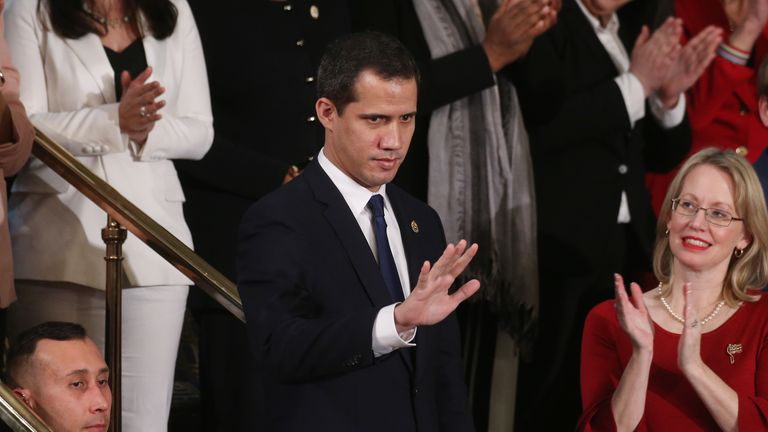 Venezuelan opposition leader Juan Guaido acknowledges applause at the State of the Union address