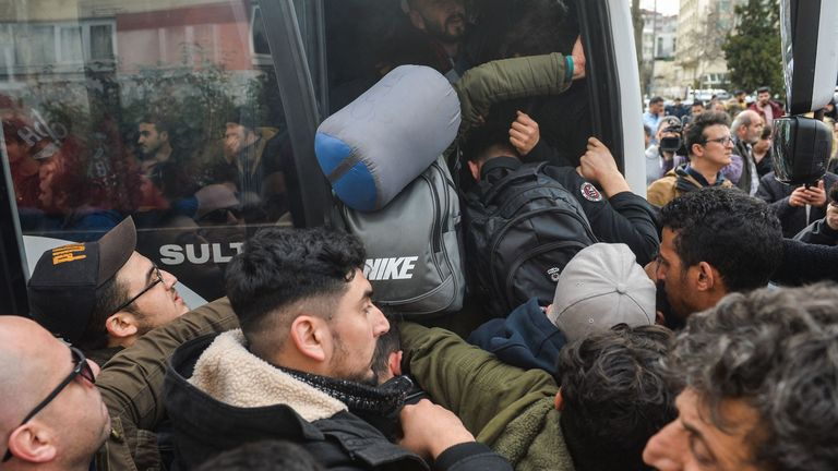 Migrants struggle to board a bus to go to the Greek border, in Istanbul, Turkey, on February 28, 2020