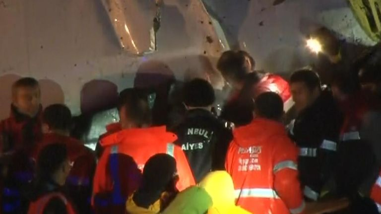 Operation on the ground in Istanbul to rescue people from wreckage of a plane crash