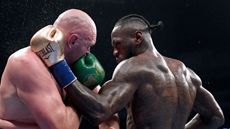 Tyson Fury and Deontay Wilder trade blows in the first bout in Los Angeles in 2018