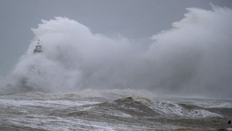 Huge waves engulf a lighthouse in Newhaven during Storm Ciara