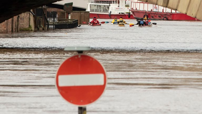 Many people are using canoes to get around after flooding, such as in York