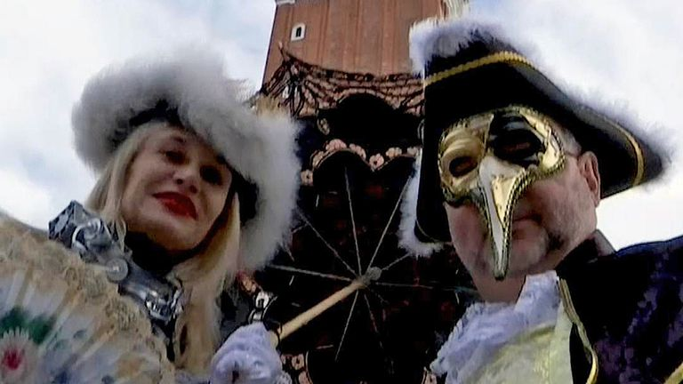 Revellers in elaborate costumes mill about St Mark's Square in Venice as the city celebrated its traditional carnival.