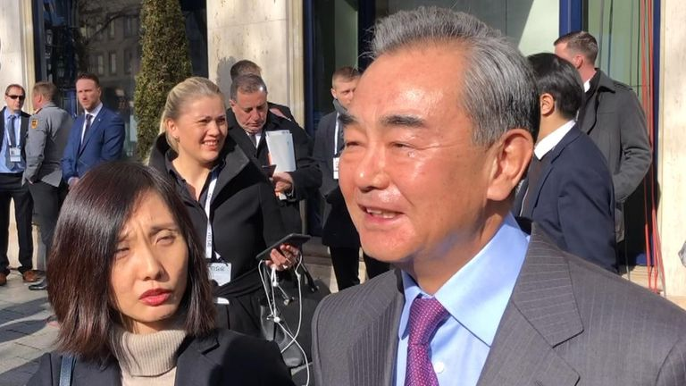 Wang Yi, pictured with his translator, has said China is making a 'sacrifice'