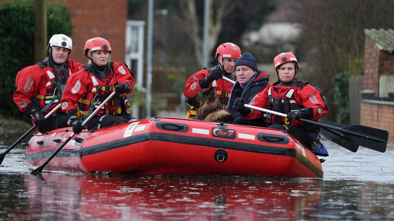 A man and his dog are rescued in  Snaith, Humberside, after the River Aire bursts its banks