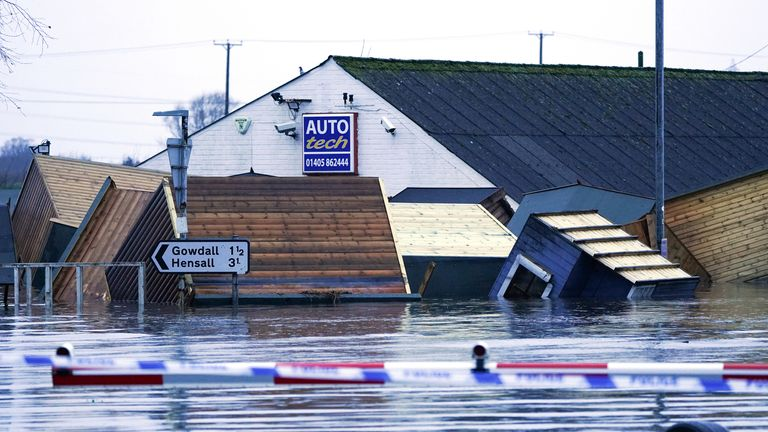 Garden sheds float in floodwater in Snaith, East Yorkshire