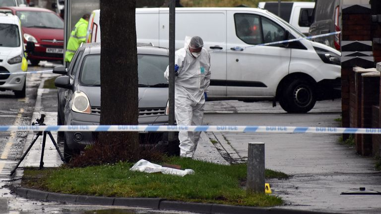 Police activity in Pensnett Road, West Midlands, as a double murder investigation has been launched after two men were knifed to death