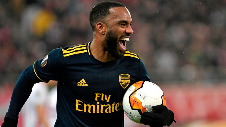 Alexandre Lacazette celebrates his goal against Olympiakos