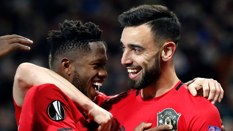 Manchester United's Bruno Fernandes (right) celebrates scoring his side's first goal with Fred