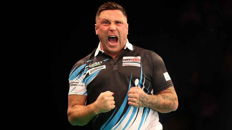 Gerwyn Price celebrates a draw in his match against Michael Smith during day two of the Unibet Premier League at Motorpoint Arena on February 13, 2020 in Nottingham, England
