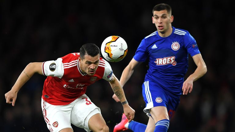 Granit Xhaka of Arsenal FC battles for possession with Lazar Randelovic of Olympiakos