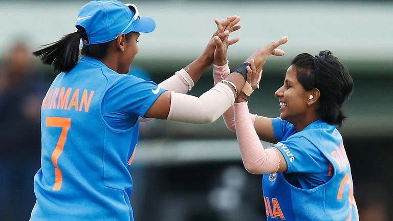 India celebrate as they beat New Zealand in the Women's T20 World Cup