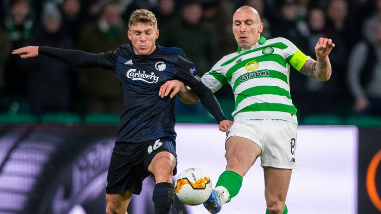 Copenhagen's Pep Biel (left) battles with Celtic's Scott Brown