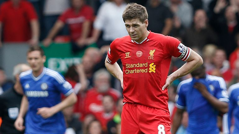 Steven Gerrard looks on after the first Chelsea goal against Liverpool in the Premier League meeting at Anfield in April 2014