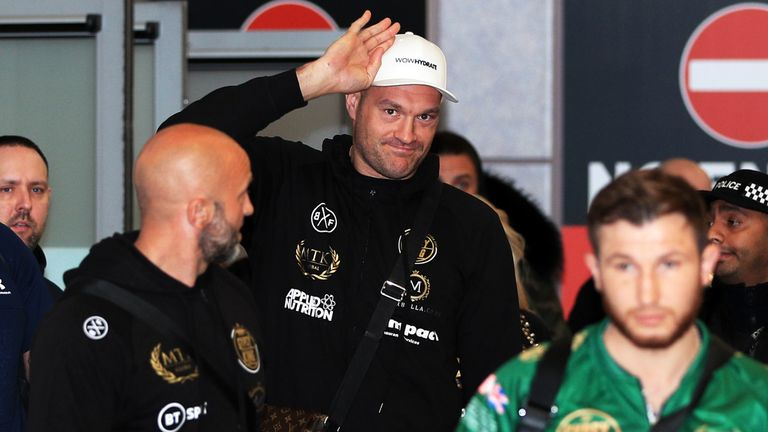 Tyson Fury arrives at Manchester Airport following his WBC heavyweight championship rematch with Deontay Wilder