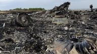 Debris at the site of the crash of flight MH17 in which 298 people died