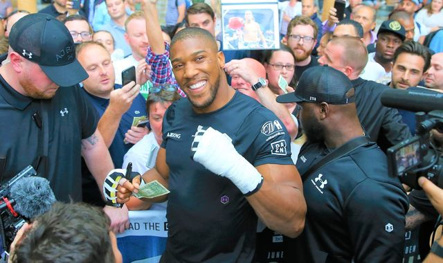 Anthony Joshua briefly forgot the mania of fight week on a whirlwind trip to New York, says Andy Clarke