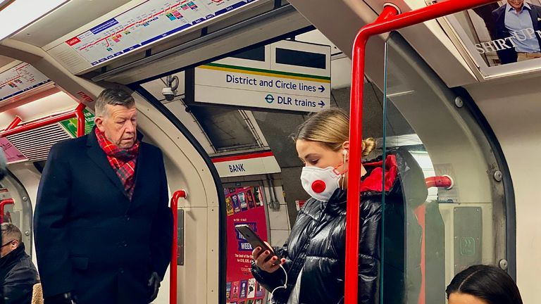 "A woman wears a protective face mask as she travels on a London tube train carriage at Bank Underground station in central London on March 3, 2020. - Up to one fifth of employees could be off work in Britain when the coronavirus outbreak peaks, the government said Tuesday outlining a new action plan. Britain had 51 confirmed cases of COVID-19 as of 9:00 am (0900 GMT), an increase of 12 in 24 hours, as Prime Minister Boris Johnson warned the count was ""highly likely"" to keep rising. (Photo by DANIEL LEAL-OLIVAS / AFP) (Photo by DANIEL LEAL-OLIVAS/AFP via Getty Images)"