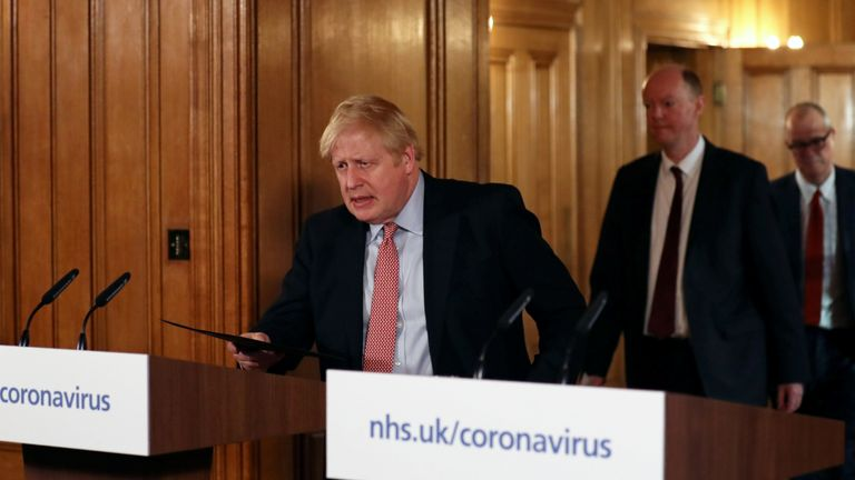 LONDON, ENGLAND - MARCH 12: Chief Medical Officer for England Chris Whitty and British Prime Minister Boris Johnson arrive to hold a news conference addressing the government's response to the coronavirus outbreak on March 12, 2020 in London, England. (Photo by Simon Dawson-WPA Pool/Getty Images)