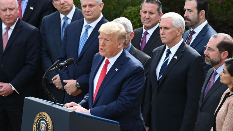 Surrounded by members of the White House Coronavirus Task Force, US President Donald Trump speaks at a press conference on COVID-19, known as the coronavirus, in the Rose Garden of the White House in Washington, DC, March 13, 2020. - Trump is declaring coronavirus a national emergency. (Photo by JIM WATSON / AFP) (Photo by JIM WATSON/AFP via Getty Images)
