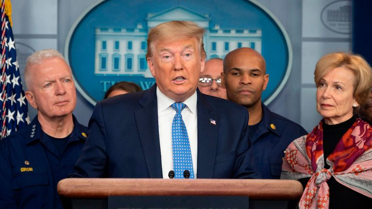 US President Donald Trump standing with members of the White House Coronavirus Task Force team, speaks during a press briefing in the press briefing room of the White House March 15, 2020 in Washington, DC. (Photo by JIM WATSON / AFP) (Photo by JIM WATSON/AFP via Getty Images)