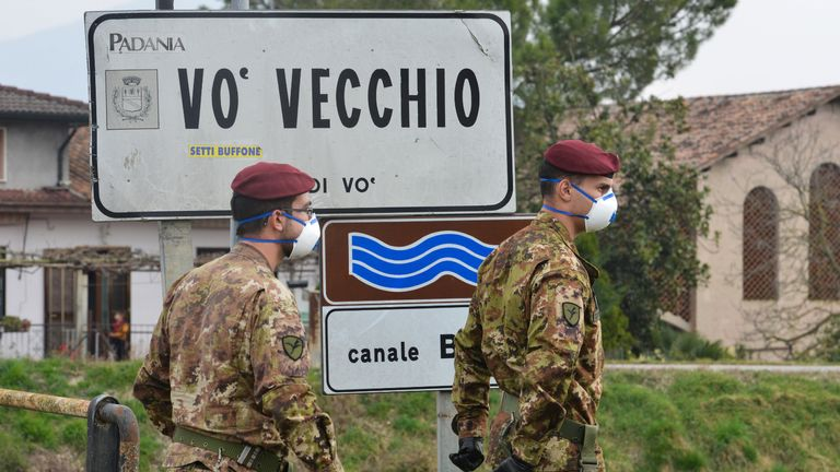 Italian soldiers patrol by a check-point at the entrance of the small town of Vo Vecchio,  situated in the red zone of the COVID-19 the novel coronavirus outbreak, northern Italy, on February 24, 2020. - Italy, the country with the most confirmed cases in Europe, reports its fifth death and the number of people contracting the disease continues to mount, with 219 people now testing positive. (Photo by MARCO SABADIN / AFP) (Photo by MARCO SABADIN/AFP via Getty Images)