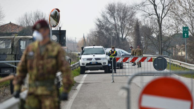 Italian soldiers patrol by a check-point at the entrance of the small town of Vo Euganeo,  situated in the red zone of the COVID-19 the novel coronavirus outbreak, northern Italy, on February 24, 2020. - Italy, the country with the most confirmed cases in Europe, reports its fifth death and the number of people contracting the disease continues to mount, with 219 people now testing positive. (Photo by MARCO SABADIN / AFP) (Photo by MARCO SABADIN/AFP via Getty Images)